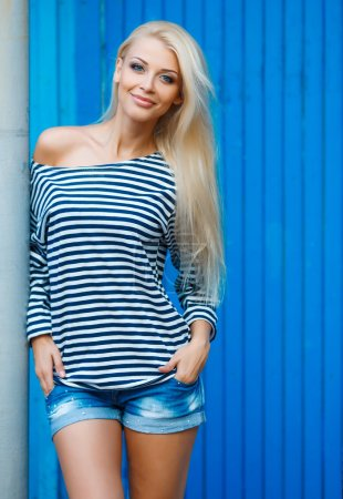 Summer portrait of the beautiful woman in a stripped vest