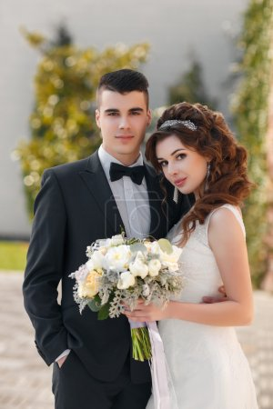 Beautiful young couple, the bride and groom