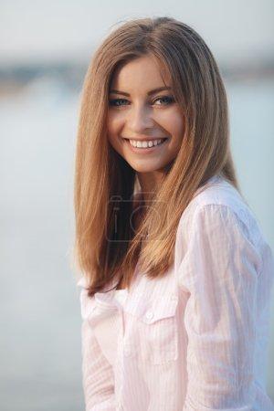 Portrait of beautiful woman on background of ocean