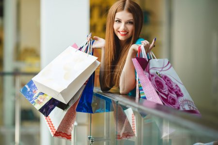 Photo for Fashion Shopping Girl Portrait. Beauty Woman with Shopping Bags in Shopping Mall. Shopper. Sales. Shopping Center - Royalty Free Image