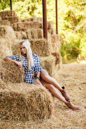 Sexy fashion woman in cow girl country style on ha...