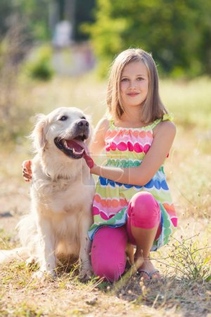 Portrait of a Girl with her beautiful dog outdoors.