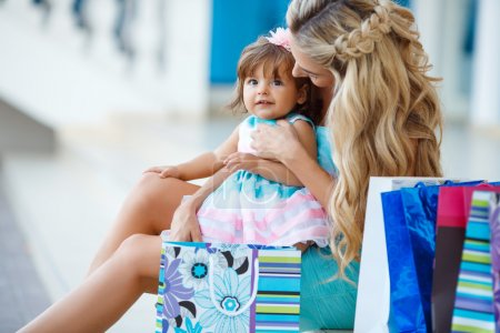 Photo for Happy family,Mother and her little daughter,go shopping with colored bags together when shopping,family shopping in a big city,a young woman during the shopping with a little girl,consumerism and people concept - Royalty Free Image