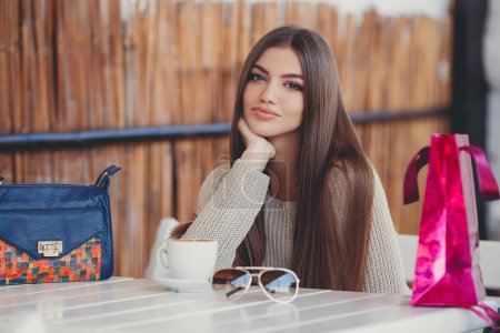 Young beautiful brunette woman with long straight ...