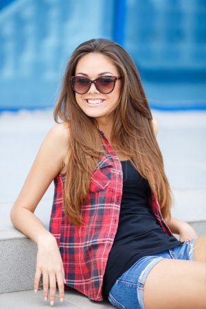 A young woman with a beautiful smile,a portrait outdoors
