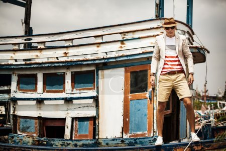 Sexy  man on old boat, fashion lifestyle concept