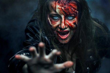 Close-up portrait of horrible zombie woman. Horror. Halloween