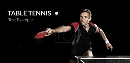 Young sports man tennis-player in play on black background. Action shot.