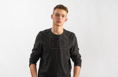 Photo for Portrait of a male caucasian teenager on gray background - Royalty Free Image