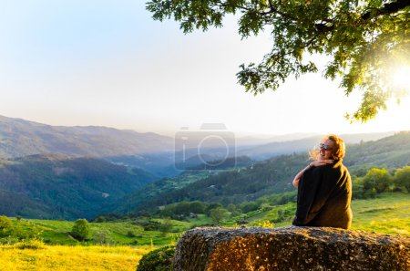 Photo for Scenic view of woman watching at sunset mountains, Peneda-Geres National Park, northern Portugal. - Royalty Free Image