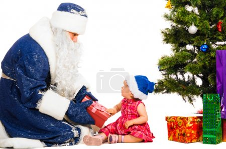 Photo for Baby and santa claus near christmas tree with gifts - Royalty Free Image