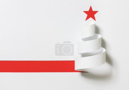 Photo for Christmas tree. Paper cut on a red background with shadow. - Royalty Free Image