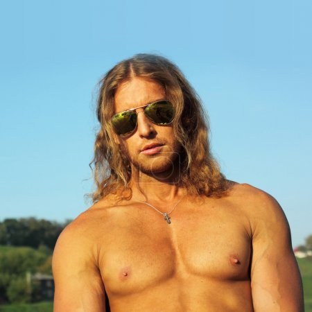 Courageous unshaven man with long hair