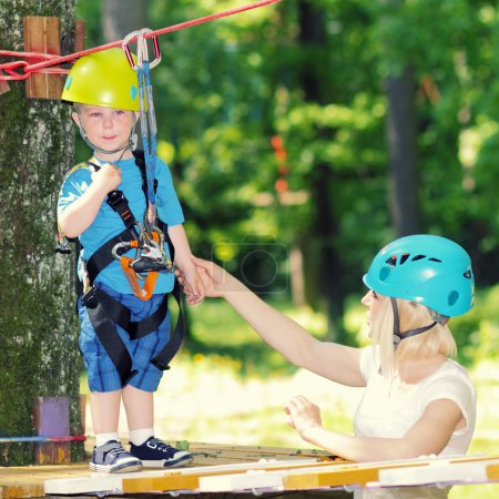 Little boy in climbing outfit