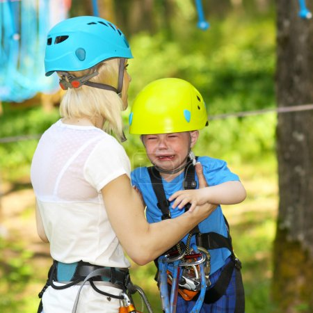 Little boy in climbing outfit crying