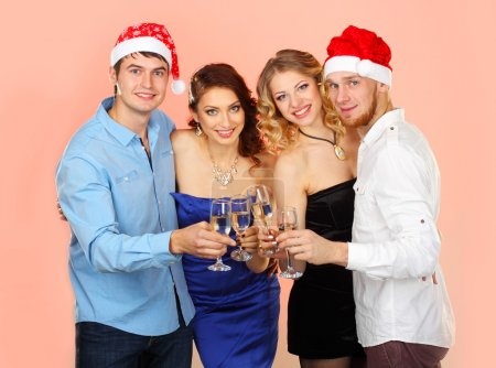 Friends with champagne at christmas party