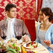 Постер, плакат: Retro couple dining in restaurant