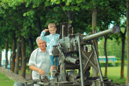 Grandfather with his little grandson on excursion