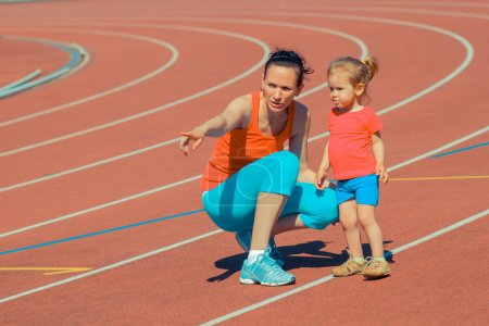 Mother and daughter sport training in stadium