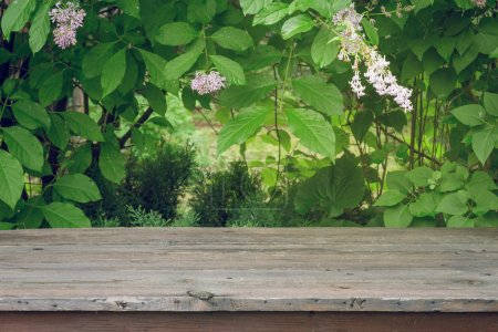 wooden table and green leaves