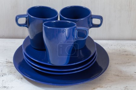 mugs and plates on table