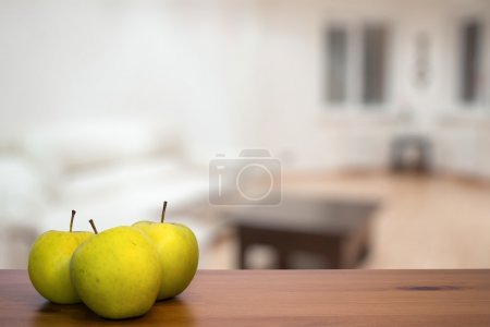 Three Green apples on table
