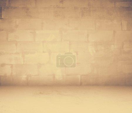Grunge interior with brick wall