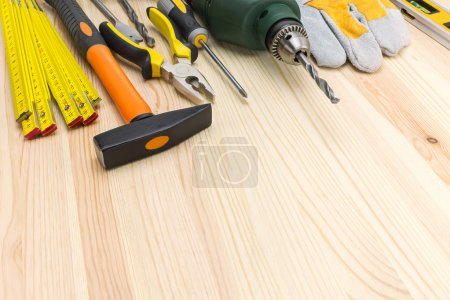 Photo for Set of working tools on wooden background with copy space - Royalty Free Image