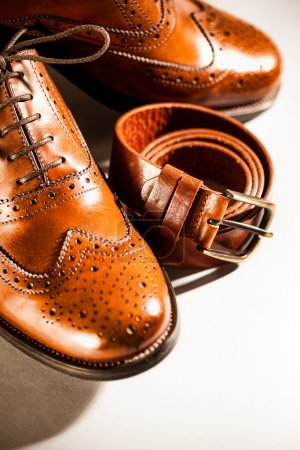Men's brogues and brown belt