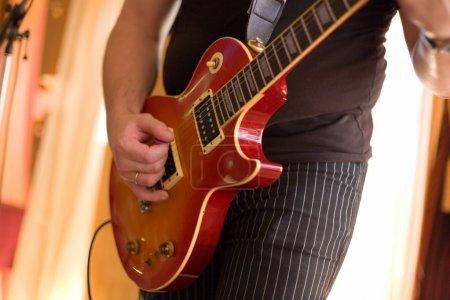 Musician play on guitar