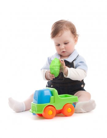 Photo for Portrait of adorable baby boy playing with generic toys - Royalty Free Image
