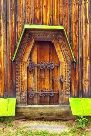 antique wooden doors on forged curtains locked