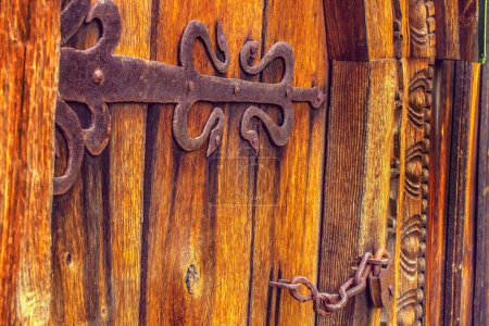 Antique wooden doors on forged curtains locke