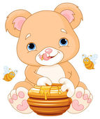 Vector illustration of cute bear eats honey