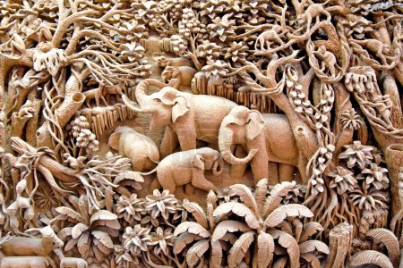 Photo for Section of an ancient mural wood carving art from Thailand. The production of things from a teak is very important for a country, therefore a factory is under the regular supervision of king of Thailand - Royalty Free Image