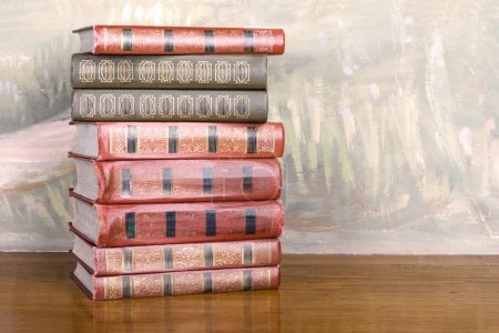 Richly decorated volumes of books with gold lettering