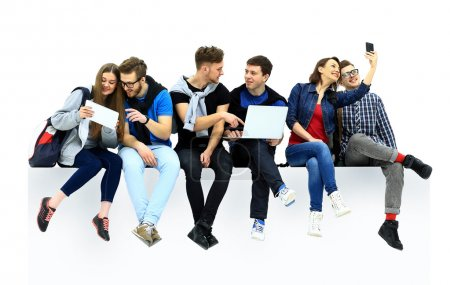 Photo for Causal group of people sitting on the floor isolated - Royalty Free Image