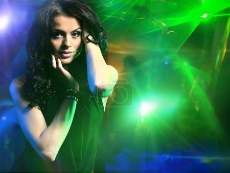 young woman dancing in the nightclub