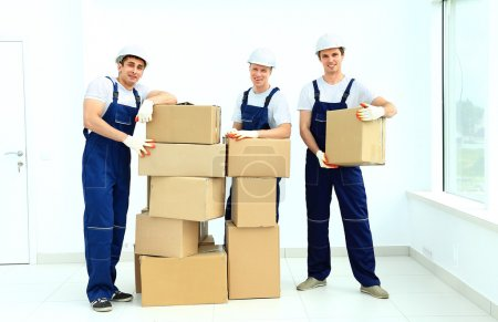 workers unload boxes