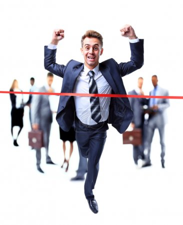 Happy businessman running through finishing line
