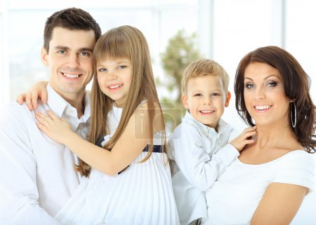 Photo for Portrait of a happy family. children in the hands of the parents - Royalty Free Image