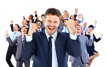 large business team celebrating success with arms raised