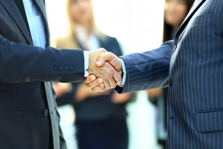 Photo for Business handshake. Business man giving a handshake to close the deal - Royalty Free Image