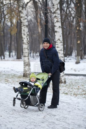 Father with two year old son in winter park