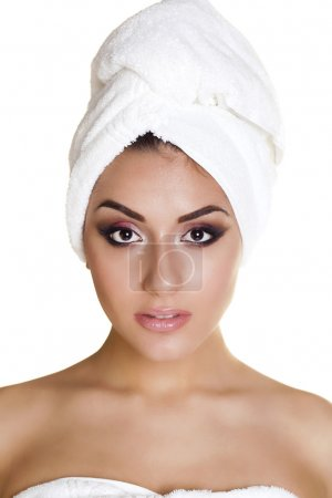 Spa. Beautiful young arabic woman in white towel, ...