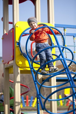 The three-year young boy on the playground