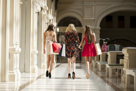 Three Young women with some shopping bags in the mall