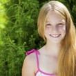 Portrait of a beautiful young blonde little girl o...