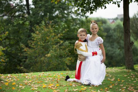 Childrens ballroom dance couple in suits