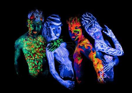 Four - Body art glowing in ultraviolet light